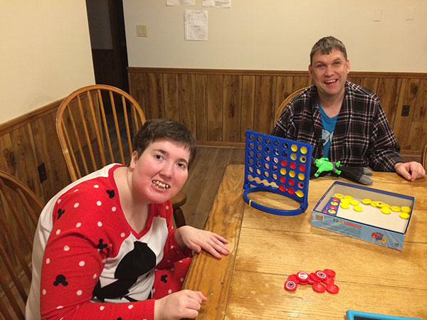 group home game 2, 2 people playing connect 4